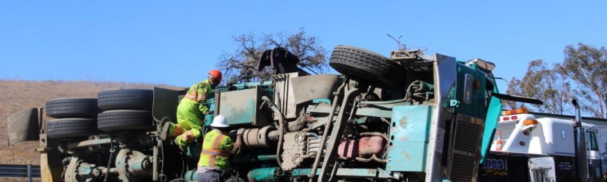 Trash Truck Overturned, North 5 at Valencia, 8am