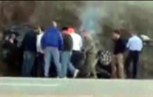 Guardsmen Pull Man from Burning Car; more