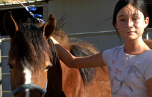 Local Girl Takes On Wild Horse Challenge