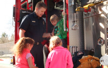 Firefighters, Police Officers and Mail Carriers Demonstrate a Day in their Life to Students