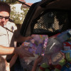 Deputy Tom Drake Gives Gifts to Neighborhood Children